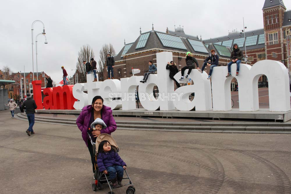 at the i amsterdam sign at the museum square amsterdam