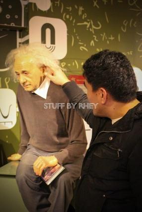 Tucking hair behind Einstein's ear at Madame Tussaud's Amsterdam