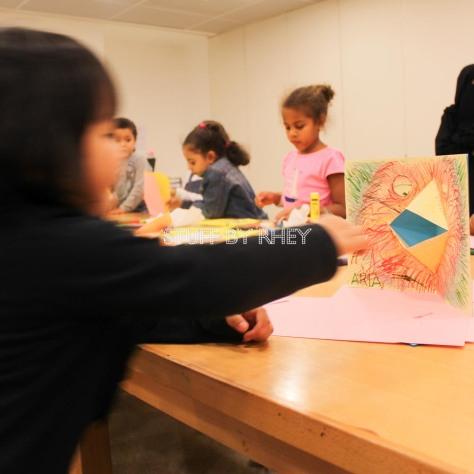 Aria's pop up card of a red bird at the kid's workshop at Museum of Islamic Art Qatar