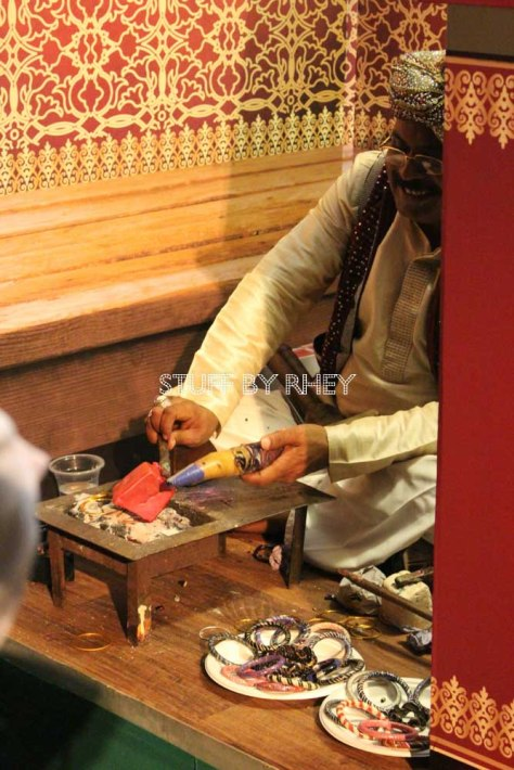 an Indian guy making bangles at the Royal Tandoor stall at the QIFF 2015