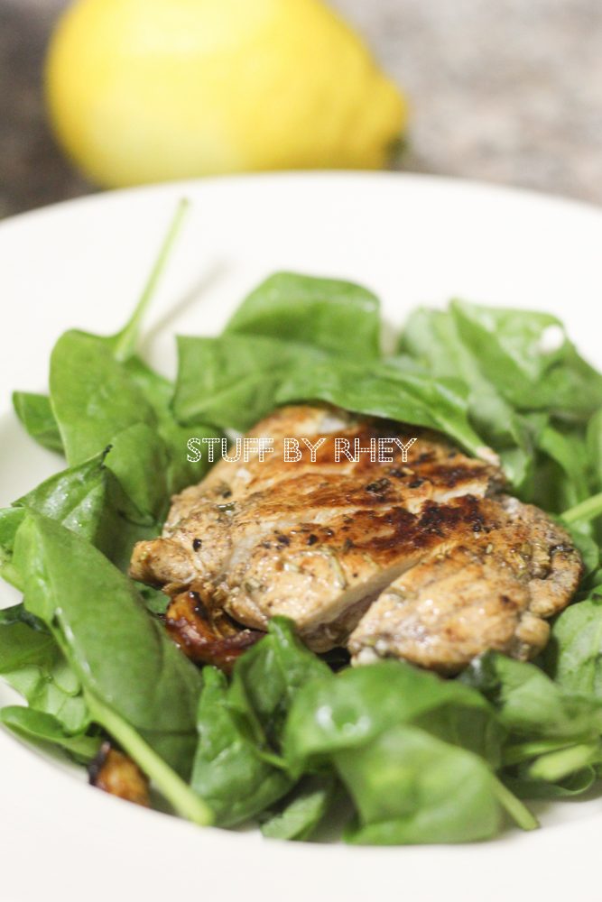 Bacon stuffed Rosemary Chicken Thighs on a bed of Arugula leaves