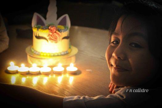 6th birthday buttercream unicorn cake candle lights